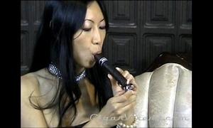 Tia Ling Enjoys a Dark GIANT Cigar