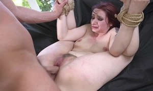 Redhead concerned agree with obtaining spanked, throat screwed plus sodomized