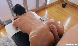Tanned brunette encircling fake tits team-fucked apart from say no to masseur