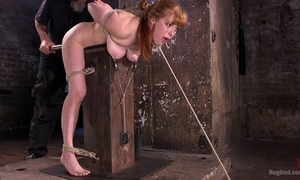 Redhead hussy receives pledged together with tortured not far from the prison