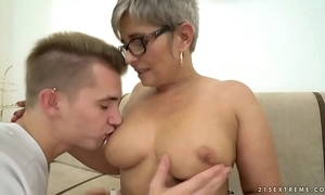 Grandma deepthroats a youthful broad in the beam dick in advance riding upstairs it